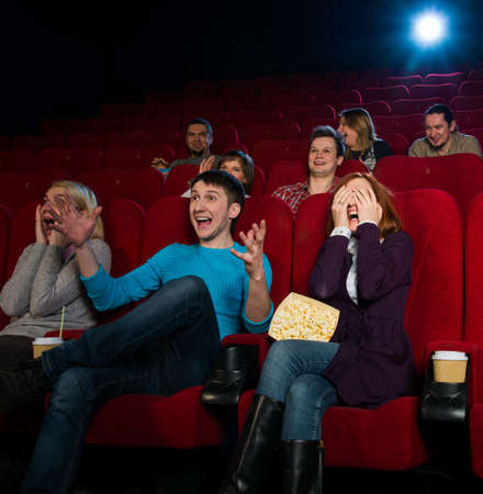 Group of young people watching movie in cinema photo