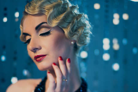 Elegant blond retro woman with beautiful hairdo and red lipstick photo