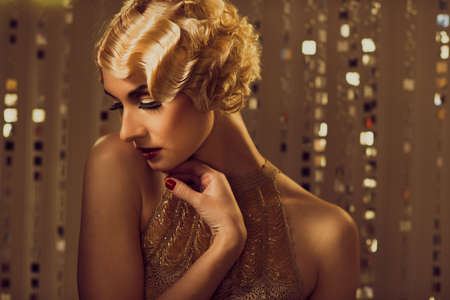 retro woman: Elegant blond retro woman  in golden dress with beautiful hairdo and red lipstick