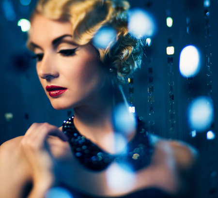 Elegant blond retro woman with beautiful hairdo and red lipstick (shallow DoF focus on lips) photo