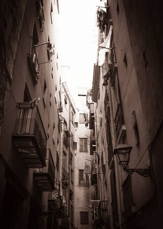 balcony window: Sepia picture of narrow street end with balconies