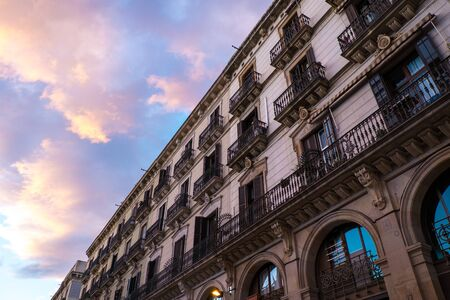 Building facade with  balconies against beautiful sky photo