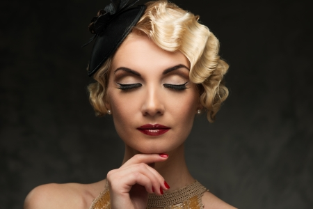 retro fashion: Elegant blond retro woman  in golden dress with beautiful hairdo and red lipstick