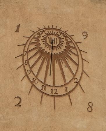 orologio da parete: Sun orologio primo piano Archivio Fotografico
