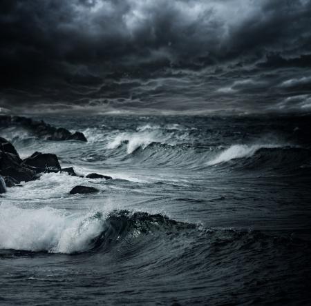 tsunami wave: Dark stormy sky over ocean with big waves Stock Photo