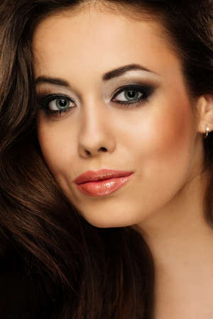 long brown hair: Portrait of a young beautiful cheerful brunette woman with make-up