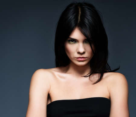 strict: Young beautiful strict brunette woman isolated on grey background