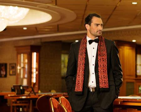 Handsome brunette wearing suit in luxury interior