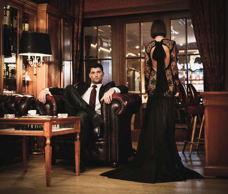 Elegant couple in formal dress in luxury cabinet  photo