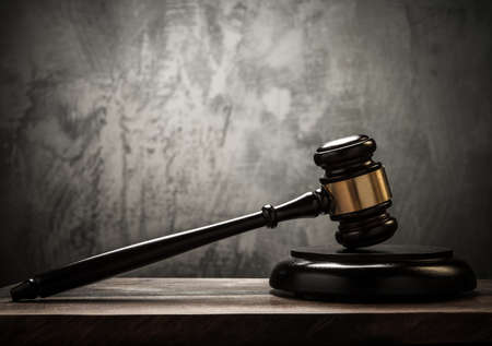 criminals: Judges hammer on wooden table