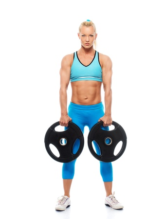 Beautiful bodybuilder girl holding weights isolated on white background
