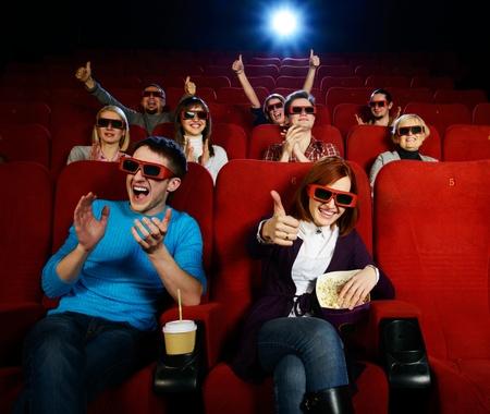 3 D の人々 のグループ メガネ シネマで映画を見て 写真素材