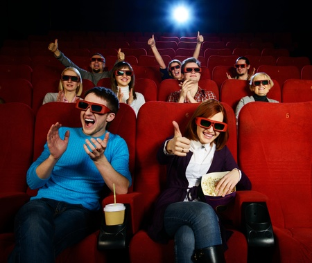 Group of people in 3D glasses watching movie in cinema 版權商用圖片