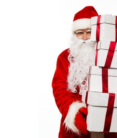 Santa Claus with gift boxes isolated on white  Stock Photo