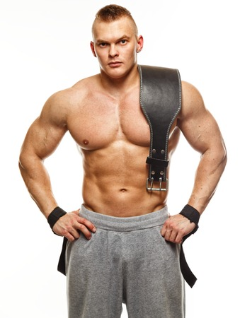 Muscular young sportsman with weight lifting belt  Reklamní fotografie