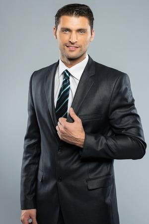 Well-dressed handsome man in black suit and tie  Zdjęcie Seryjne