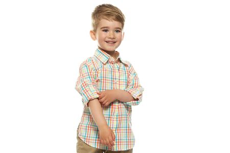 Little positive boy isolated on white background