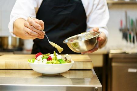 Chief cook preparing salad Stock Photo