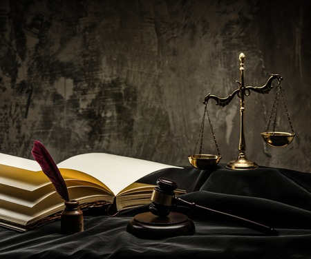 Scales and wooden hammer on judge's mantle Stok Fotoğraf - 25740216