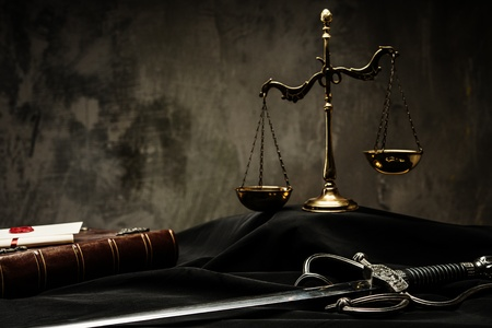 Scales, book and Sword of Justice on a judges mantle Stock Photo