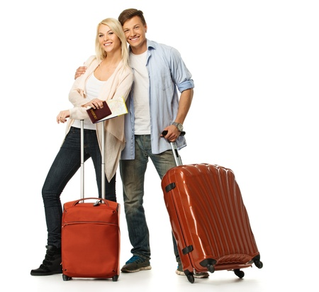 Happy couple with suitcases and map 版權商用圖片