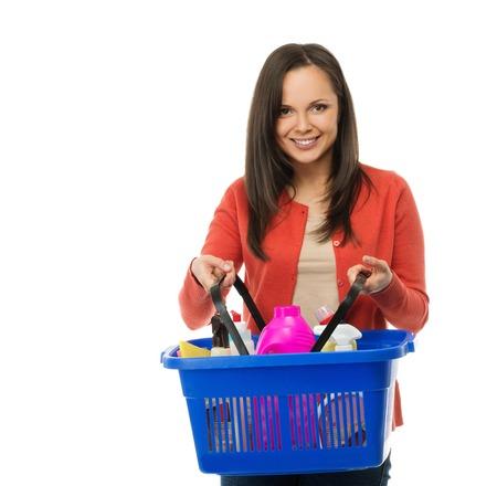 Beautiful cheerful brunette woman with basket full of cleansers  Zdjęcie Seryjne