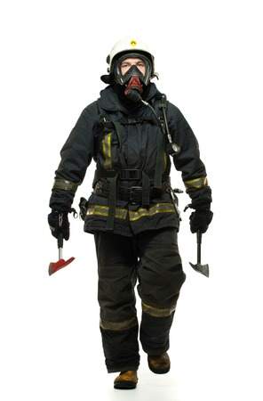 Firefighter with axes and wearing oxygen mask isolated on white  Фото со стока