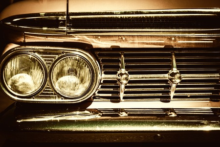 grille: Close-up of retro car facia with chrome grille Stock Photo
