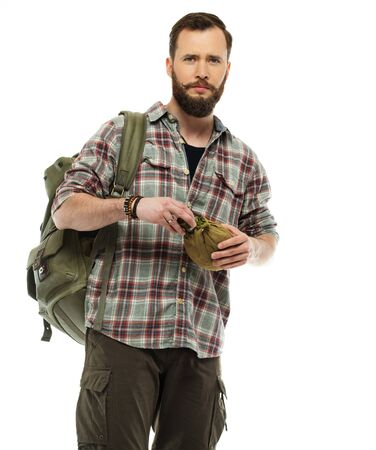 Handsome traveler with backpack and flask isolated on white  photo