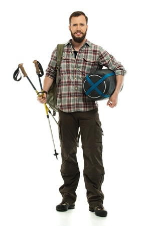 Traveler with backpack, hiking poles and sleeping bag  photo