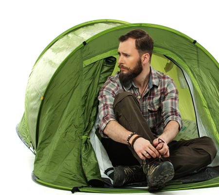 Handsome traveler in a tent  photo