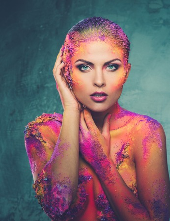 fantasy makeup: Beautiful young woman with conceptual colourful body art  Stock Photo