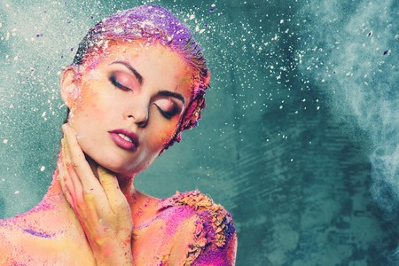 mind body spirit: Beautiful young woman with conceptual colourful body art  Stock Photo