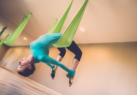 Young woman performing antigravity yoga exercise Imagens - 30807073