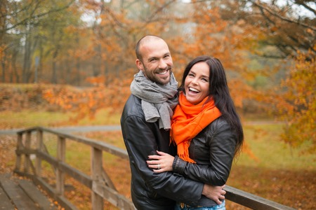 Happy middle-aged couple outdoors on beautiful autumn day Stock Photo