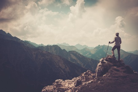 Woman hiker on a top of a mountain  Stockfoto