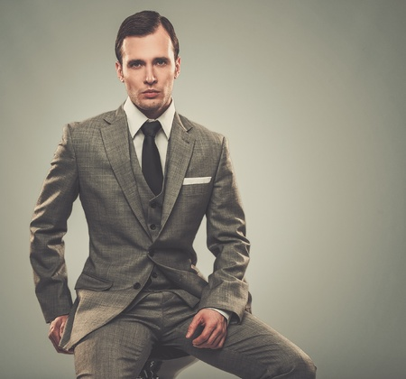Well-dressed man in grey suit Stock Photo