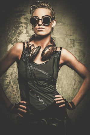 Attractive steampunk girl wearing googles