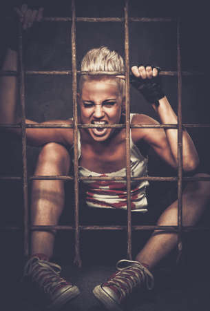 Troubled teenager girl behind bars
