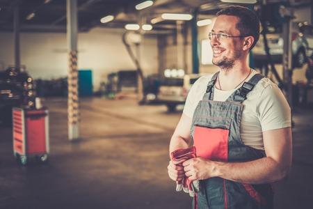 Serviceman in a car workshop