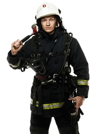 Young firefighter with helmet and axe isolated on white Stock Photo