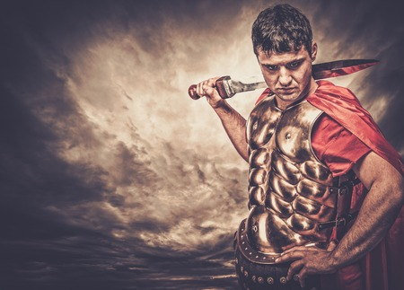 Legionary soldier against stormy sky Banque d'images