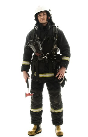 Young firefighter with helmet and axe isolated on white Фото со стока