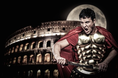 Roman legionary soldier in front of coliseum at night time Stock Photo - 35513650