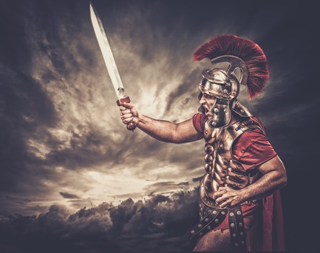 Legionary soldier against stormy sky Stock Photo