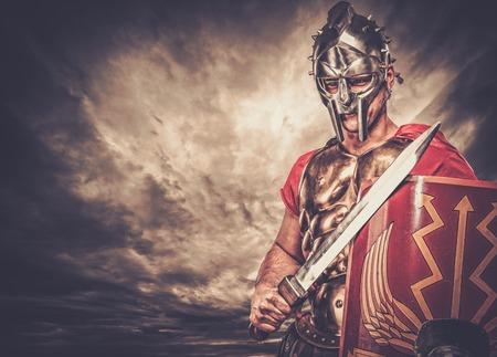 Legionary soldier against stormy sky Stockfoto
