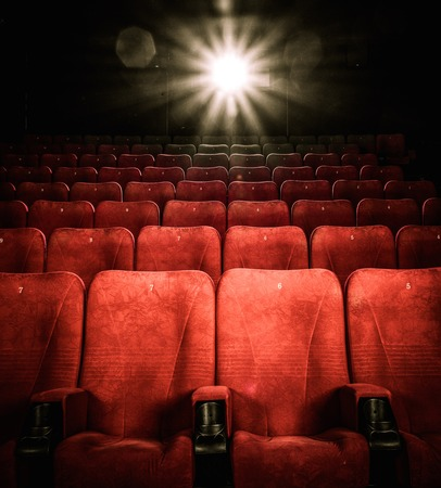 Empty comfortable red seats with numbers in cinema Imagens