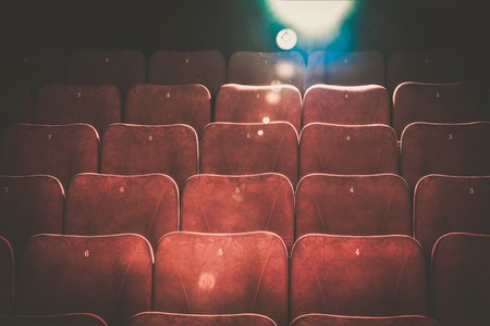 Empty comfortable red seats with numbers in cinema Stockfoto