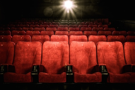Empty comfortable red seats with numbers in cinema 스톡 콘텐츠