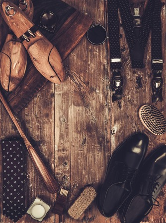 Shoe care and gentlemans accessories on a wooden table